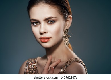 pretty woman with makeup or golden dress cosmetics jewelery lips luxury party model