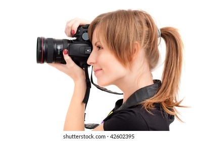 Pretty woman making photo with professional camera. Side view over white background