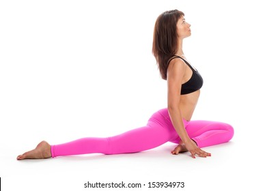 Pretty woman in pigeon yoga pose. Isolated on white studio background.