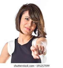 Pretty woman pointing over white background