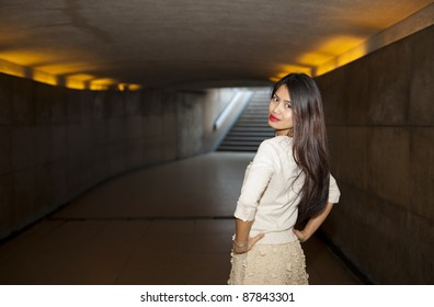 pretty woman posing in the subway area of paris