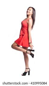 pretty woman posing wearing a red dress