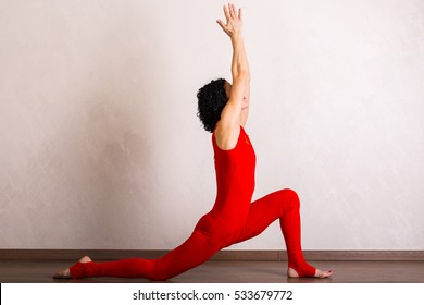 Pretty woman practicing yoga at home