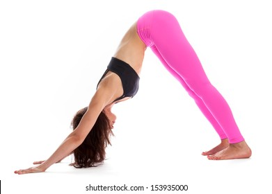 Pretty woman in rdownward facing dog pose. Isolated on white studio background.
