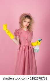 Pretty woman ready to do housework. Housework helper in rubber gloves with cloth and sprayer bottle. Extreme clean.