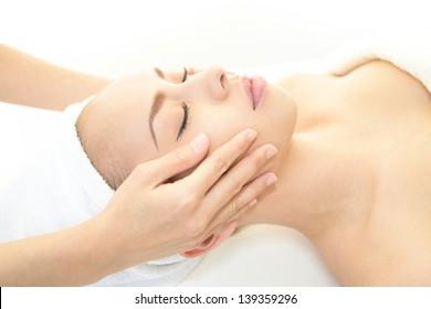 Pretty woman receiving facial massage
