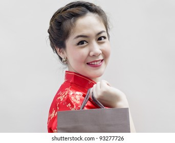pretty woman in red Traditional Chinese Cheongsam with shopping bag