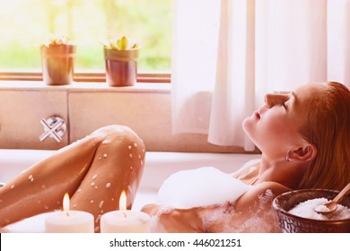 Pretty woman relaxing in the bathtub, spending peaceful time in a luxury spa resort, enjoying dayspa
