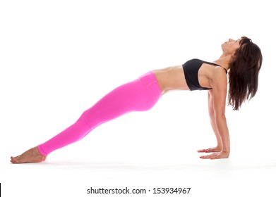 Pretty woman in reverse plank yoga pose. Isolated on white studio background.