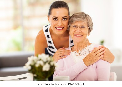 pretty woman and senior mother at home