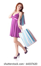 Pretty woman with shopping bags on a white background
