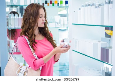 Pretty woman shopping for cosmetics at the pharmacy