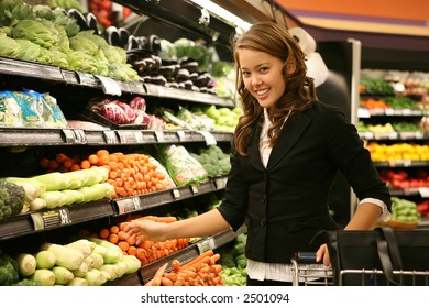 A pretty woman shopping for vegetables in the supermarket