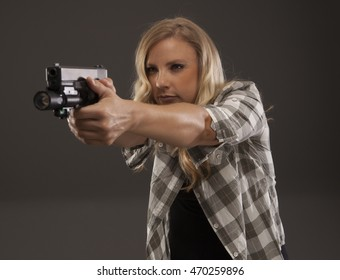 Pretty woman sighting in with a pistol.
