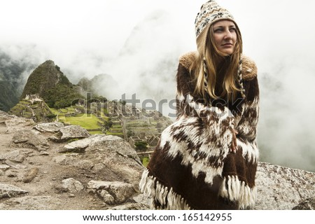 Pretty woman sitting at machu picchu in Peru