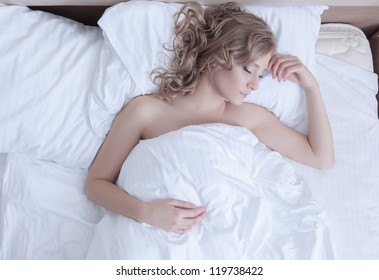 Pretty woman sleep in morning bed