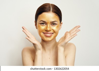 Pretty woman with a smile on her face cosmetic mask