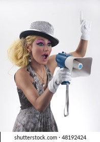 pretty woman speaking with megaphone and a hand raised