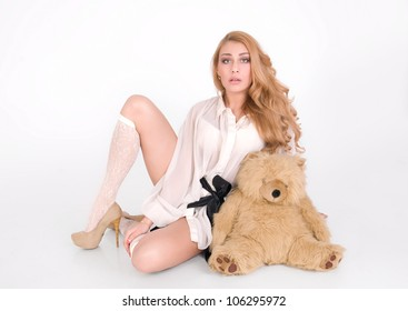 Pretty woman with sweet toy, sit and request