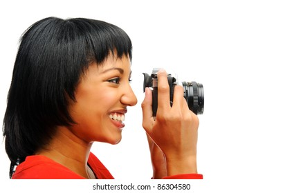 Pretty woman takes a picture with a vintage SLR camera