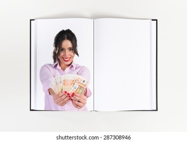 Pretty woman taking a lot of money printed on book