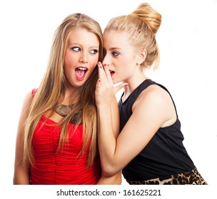 Pretty woman telling a secret to her friend isolated on a white background