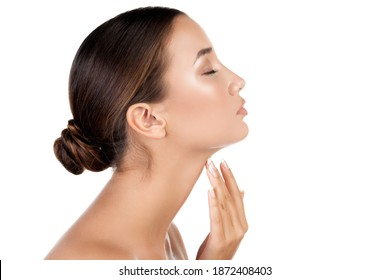Pretty woman touching her neck, isolated on white background