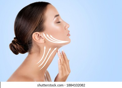 Pretty woman touching her neck, light blue background.. Anti-aging concept.