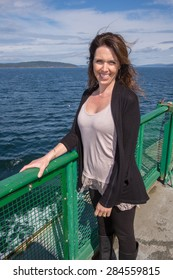 Pretty woman traveling on a ferry boat over the ocean