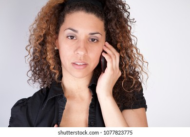 Pretty woman using mobile device looking concerned isolated white background