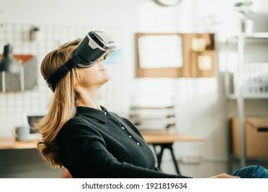 Pretty woman using vr headset enjoying virtual reality