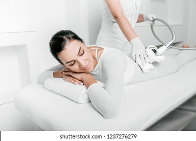 Pretty woman wearing lpg suite getting a lpg massage on her body