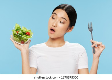 Pretty woman white t-shirt vegan salad health food intake