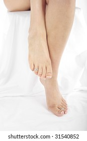 Pretty woman's legs and feet isolated over white