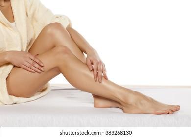 pretty women applied cream on her legs