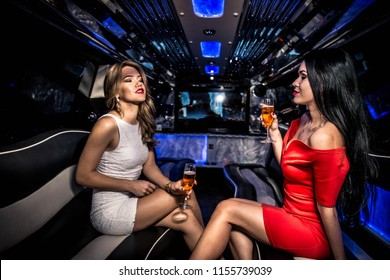 Pretty women having party in a limousine car