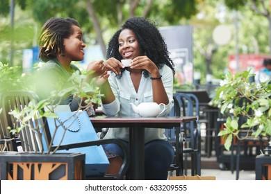 Pretty women having tea in outdoor cafe