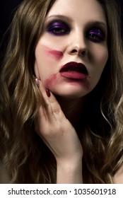 Pretty women  violet eye shadows and dark lips make up