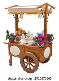 Pretty wooden portable traditional italian picturesque ice cream cart with umbrella on white background for easy selection - image wiyh copy space