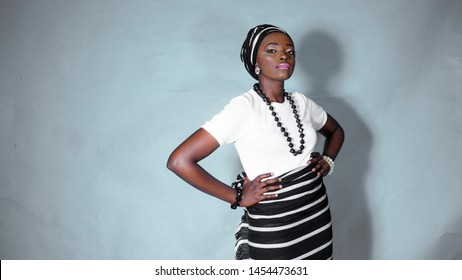 Pretty young African woman dressed in black & white traditional attire