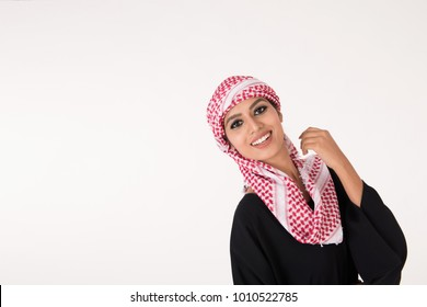 pretty young Arab female in traditional dress posing on white background