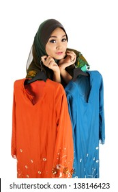 Pretty young Asian Muslim woman posses shopping with Baju Kurung action. Islamic fashionable attire concept