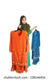 Pretty young Asian Muslim woman posses shopping with Baju Kurung action. Islamic  fashionable attire concept dba621a5ef
