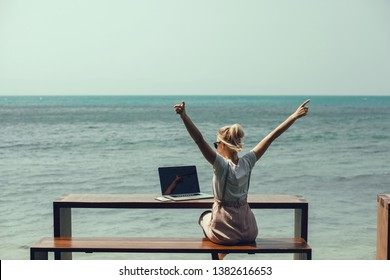 Pretty Young Beauty Woman Using Laptop in cafe, outdoor portrait business woman, hipster style, internet, smartphone, office, Bali Indonesia, holding, mac OS, manager, freelancer, hand Up, winner