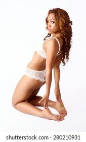 pretty young black girl posing in white lingerie