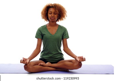 Pretty young black woman doing yoga exercise on mat isolated over white