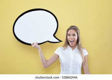 pretty young blond caucasian woman thinking with comic baloon  on yellow background