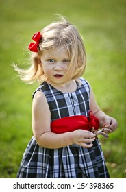 Pretty young blond girl outside portrait
