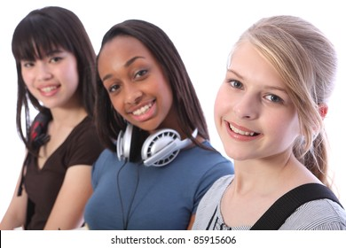 Pretty young blonde caucasian student girl with two other multi ethnic teenage friends, an oriental Japanese and African American mixed race girl, all with happy smiles.
