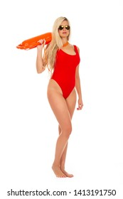 Pretty young blonde lifeguard in red sexy swimsuit with lifeguard rescue can floating buoy tubeon the white background. Concept Woman in Swimsuite.